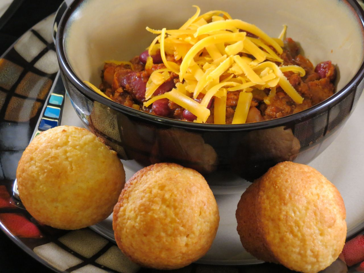 Superbowl Chili with cheddar cheese and cornbread