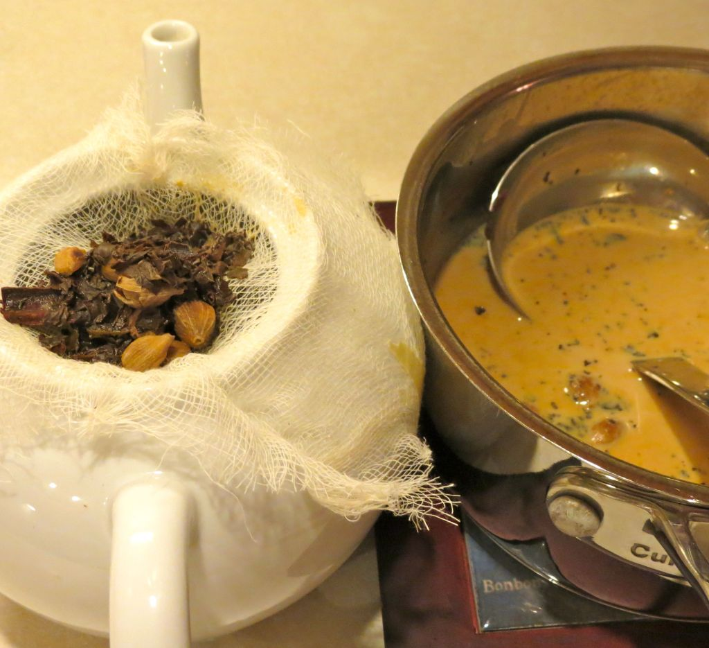 Chai straining into tea pot