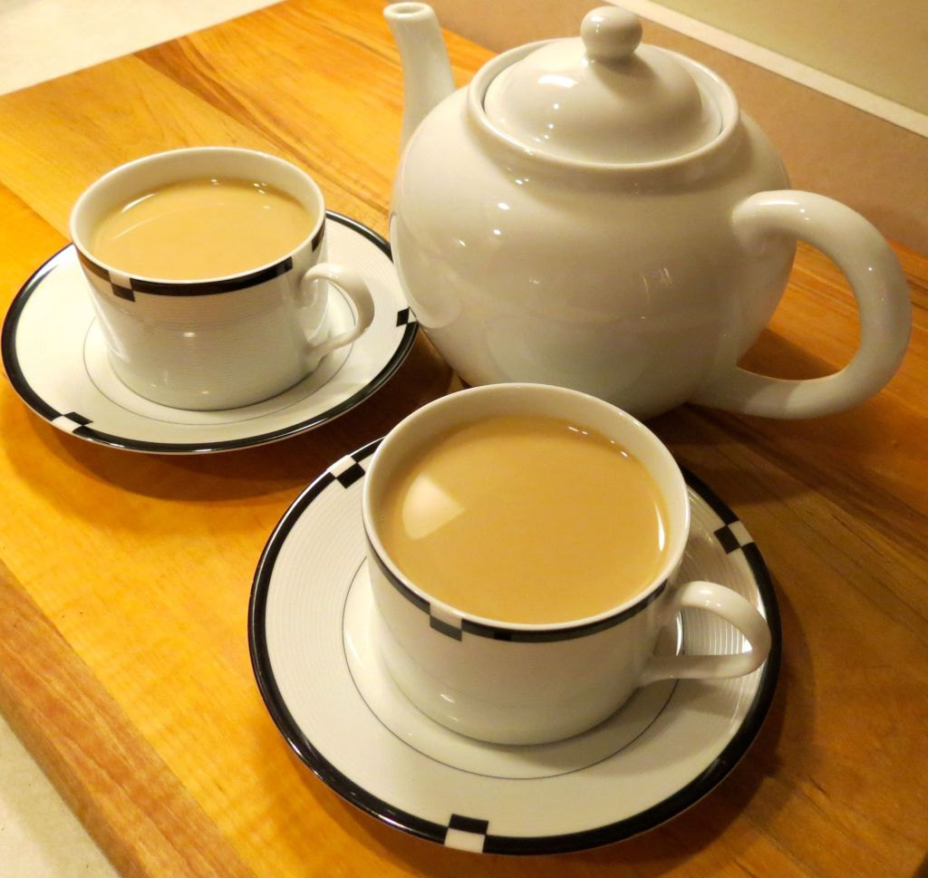 Chai tea poured with tea pot