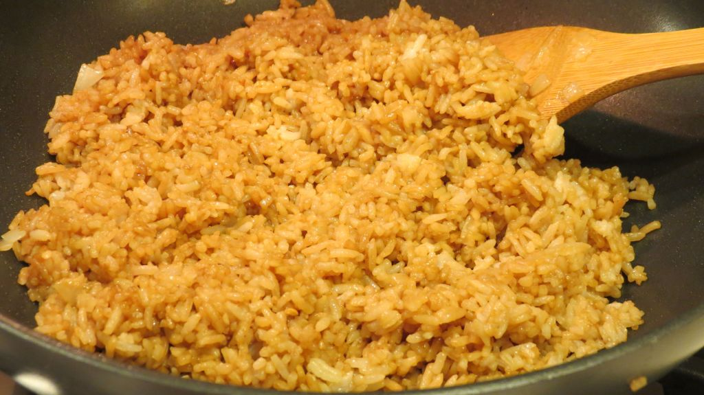 Simple Fried Rice add sauce to rice