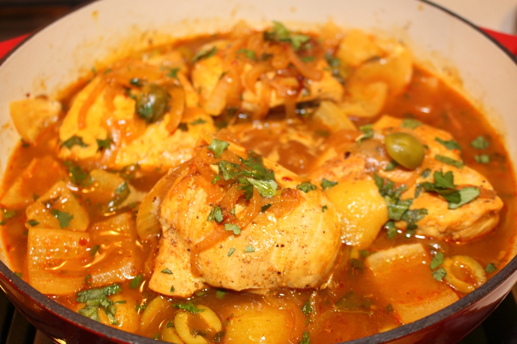 Moroccan Chicken with preserved lemons and green olives in braising ...
