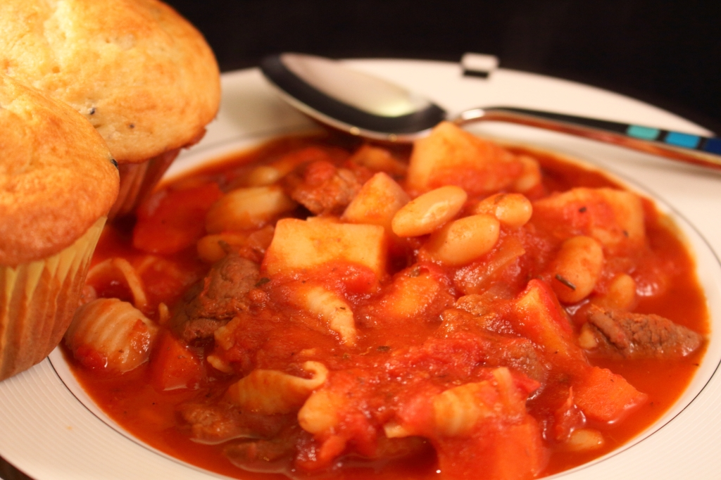 Tomatoe Based Beef Stew with Red Wine Undertones served in a bowl