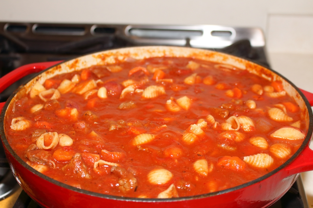 Tomatoe Based Beef Stew with Red Wine Undertones served in a braising pan