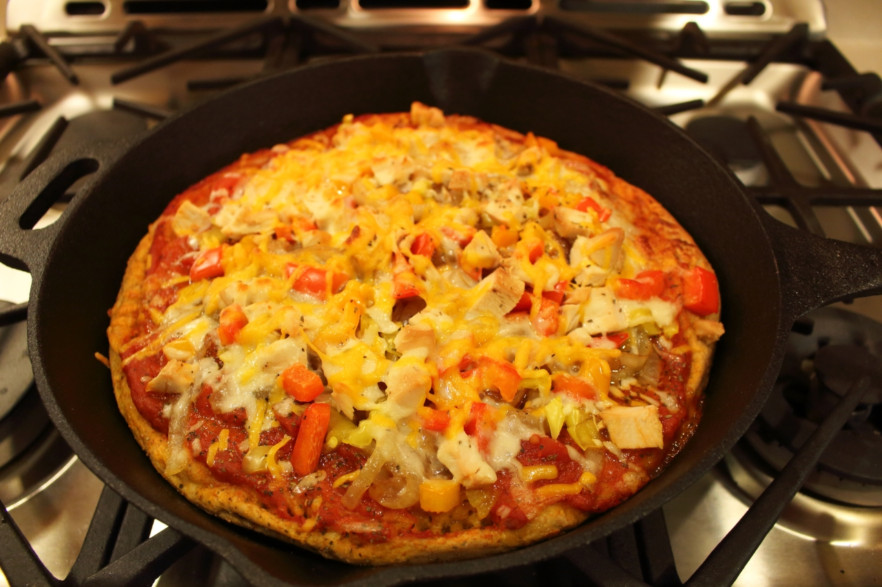 Rustic Cast Iron Vegetable Pizza Topped with BBQ Chicken out of oven photo