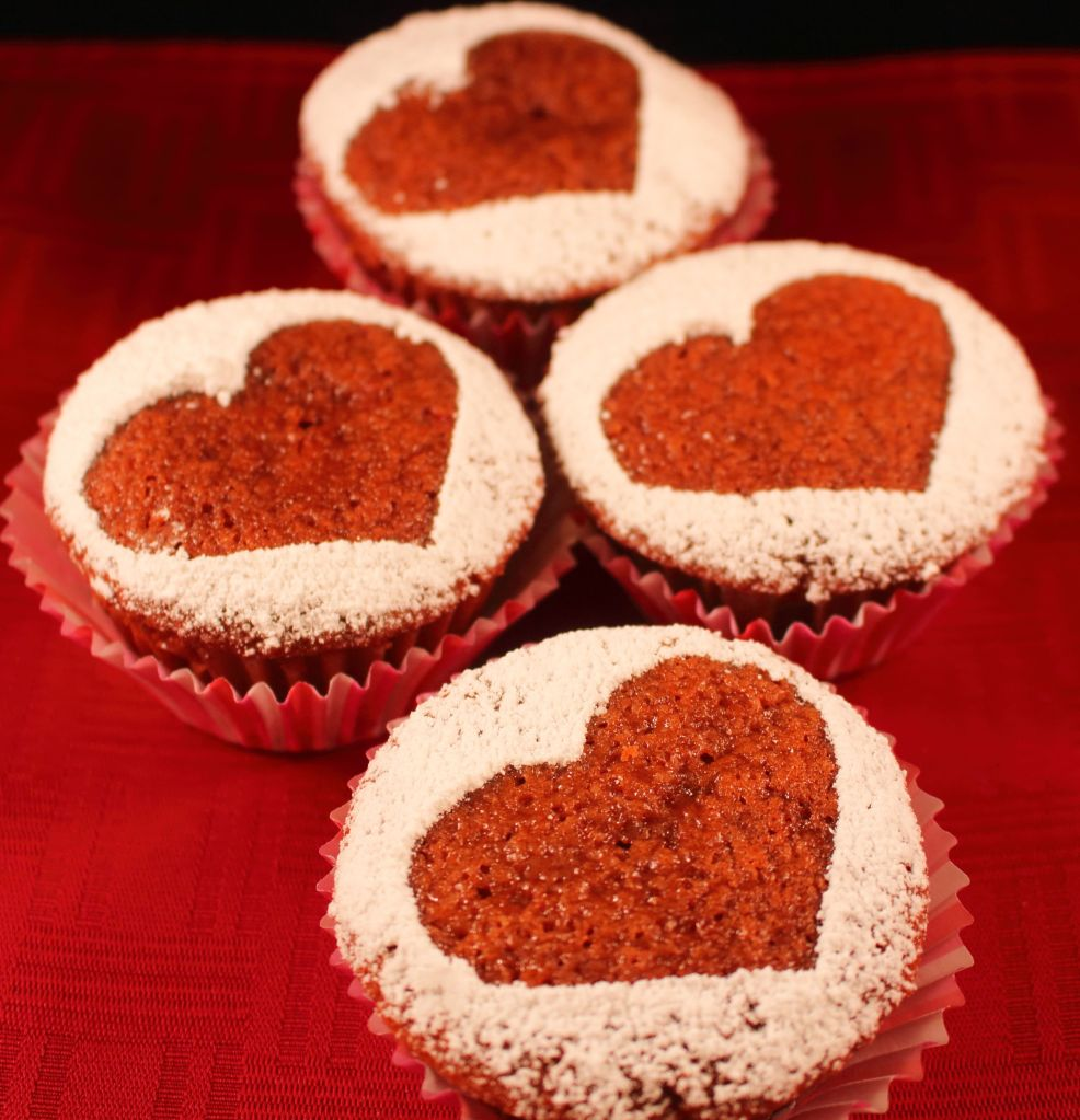 Red Velvet Cupcakes close up with powdered sugar