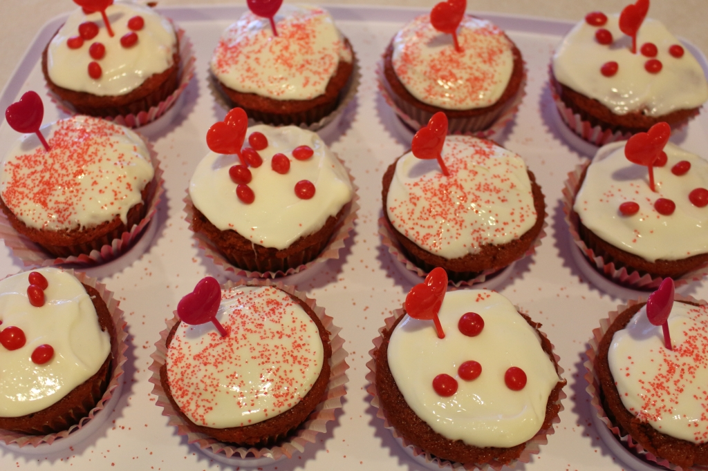 Red Velvet Cupcakes lots of them decorated