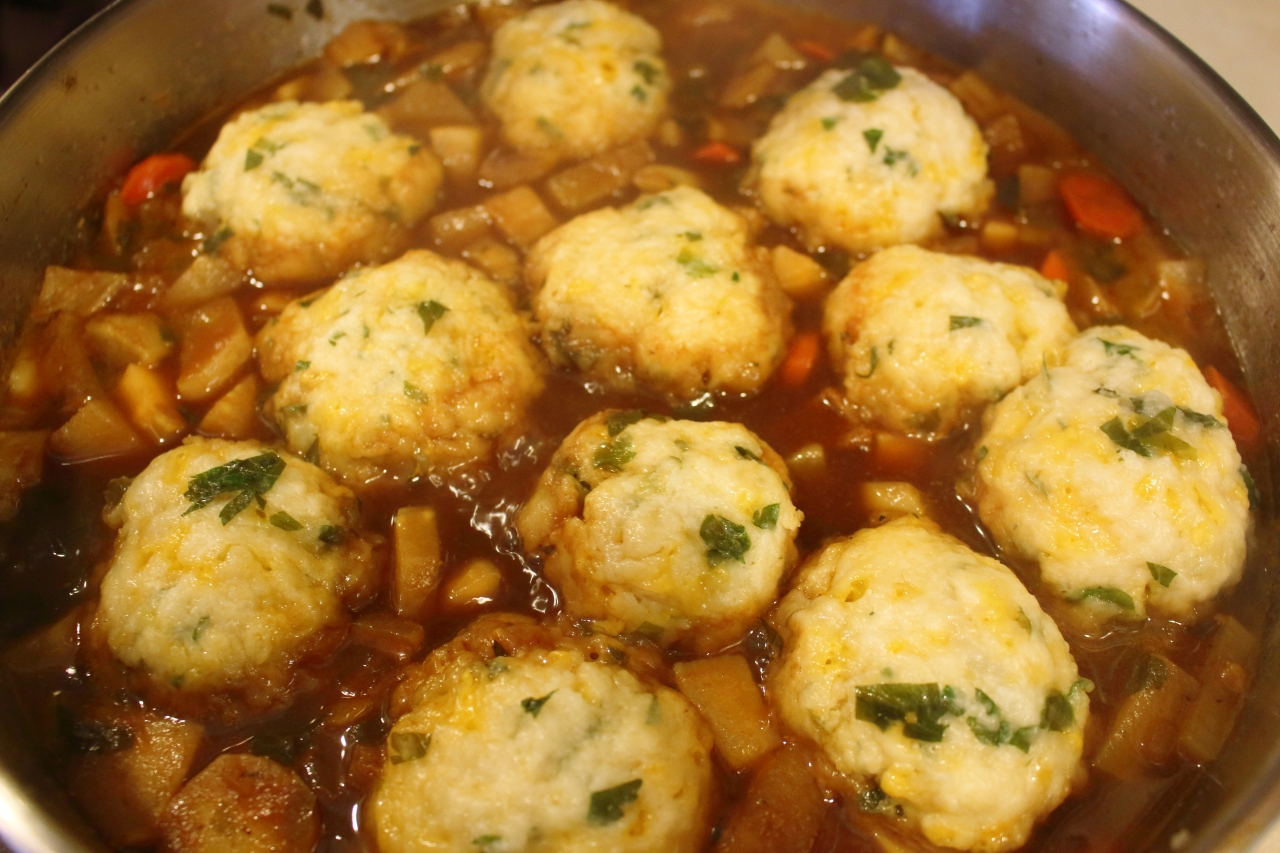 Guinness Beef Stew with Turnips and Parnsips cheddar herb dumplings after steaming