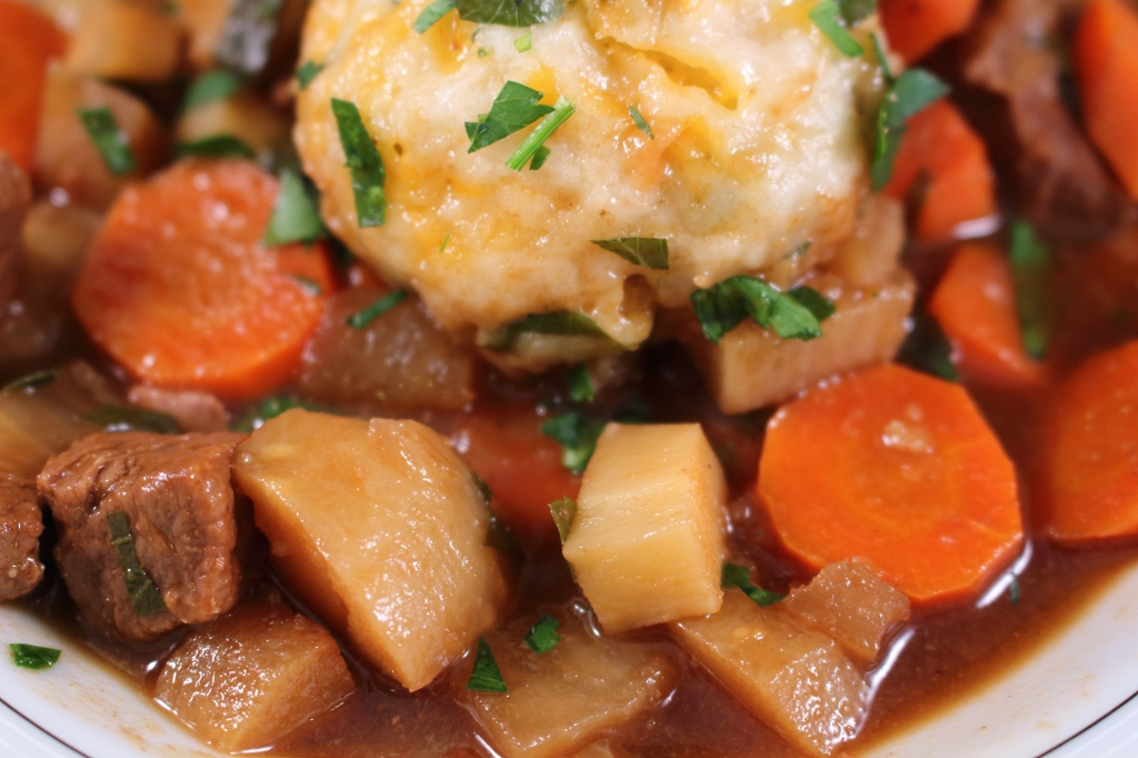 Guinness Beef Stew with Turnips and Parnsips cheddar herb dumplings closeup