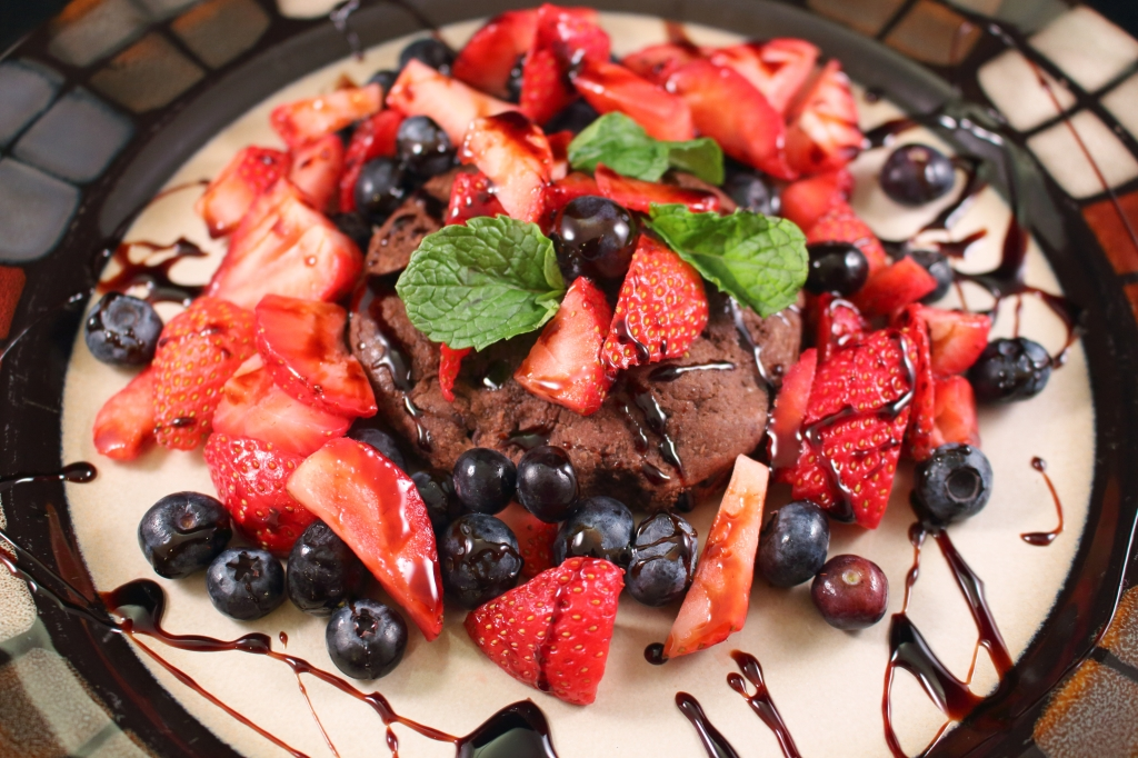 Strawberry and Blueberry Chocolate Shortcake with Reduced Balsamic Glaze on a dinner plate
