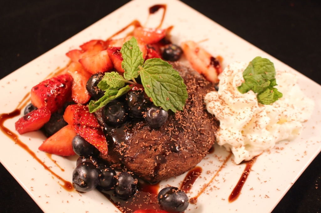 Strawberry and Blueberry Chocolate Shortcake with Reduced Balsamic Glaze on a white plate