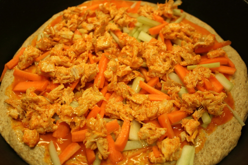 Super Bowl Cast Iron Skillet Authentic Buffalo Wing Pizza Topped with Carrots celery and chicken