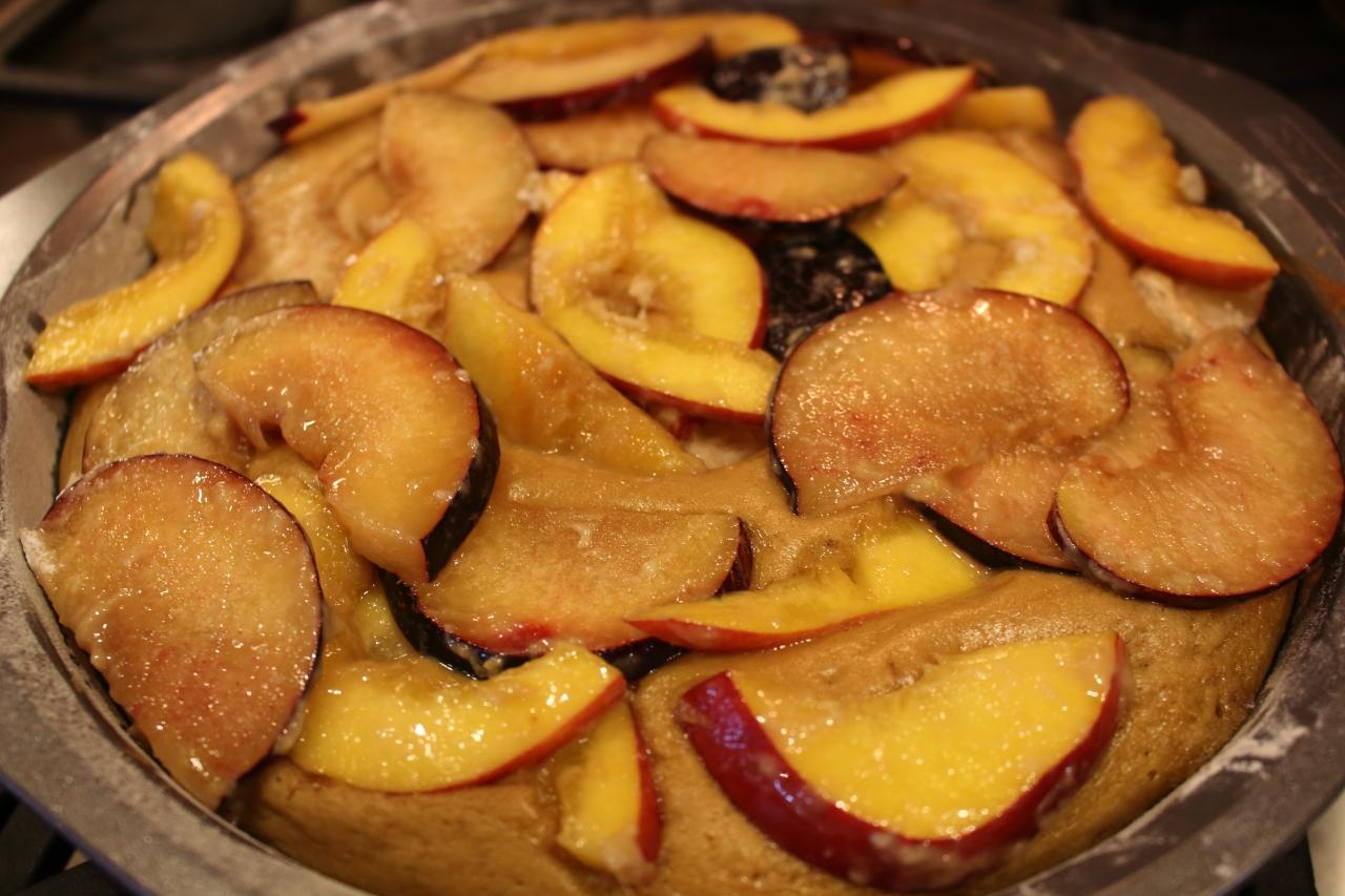 Gingery Nectarine and Plum Cake - fruit topped on cake before baking