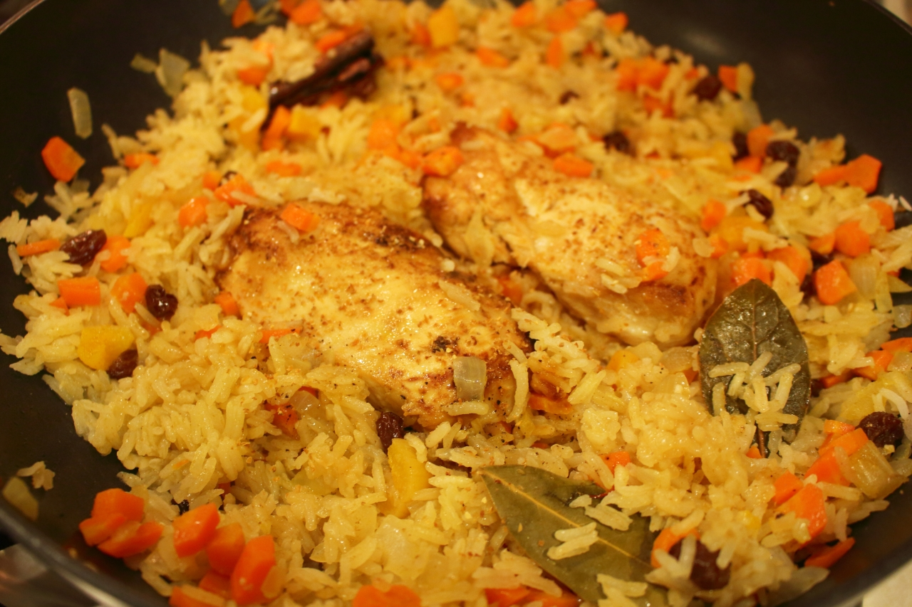 Cast Iron Skillet Chicken with a Fruit Rice Pilaf Topped off with a Splash of Orange Liqueur in the pan