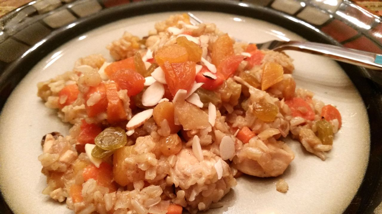 Cast Iron Skillet Chicken with a Fruit Rice Pilaf Topped off with a Splash of Orange Liqueur Plated 1
