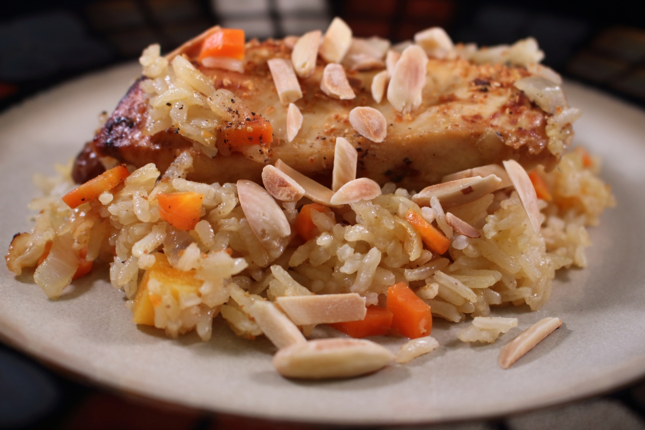 Cast Iron Skillet Chicken with a Fruit Rice Pilaf Topped off with a Splash of Orange Liqueur plated