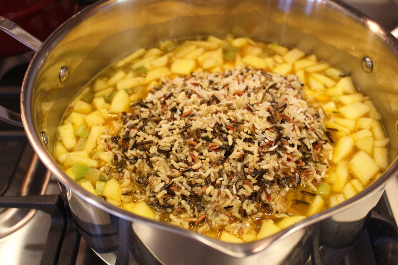 Wild Rice Cranberry Dressing with Pine Nuts on the stove top