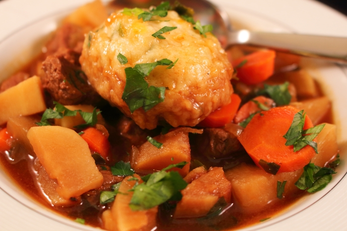 Guinness Beef Stew with Turnips and Parnsips cheddar herb dumplings plated