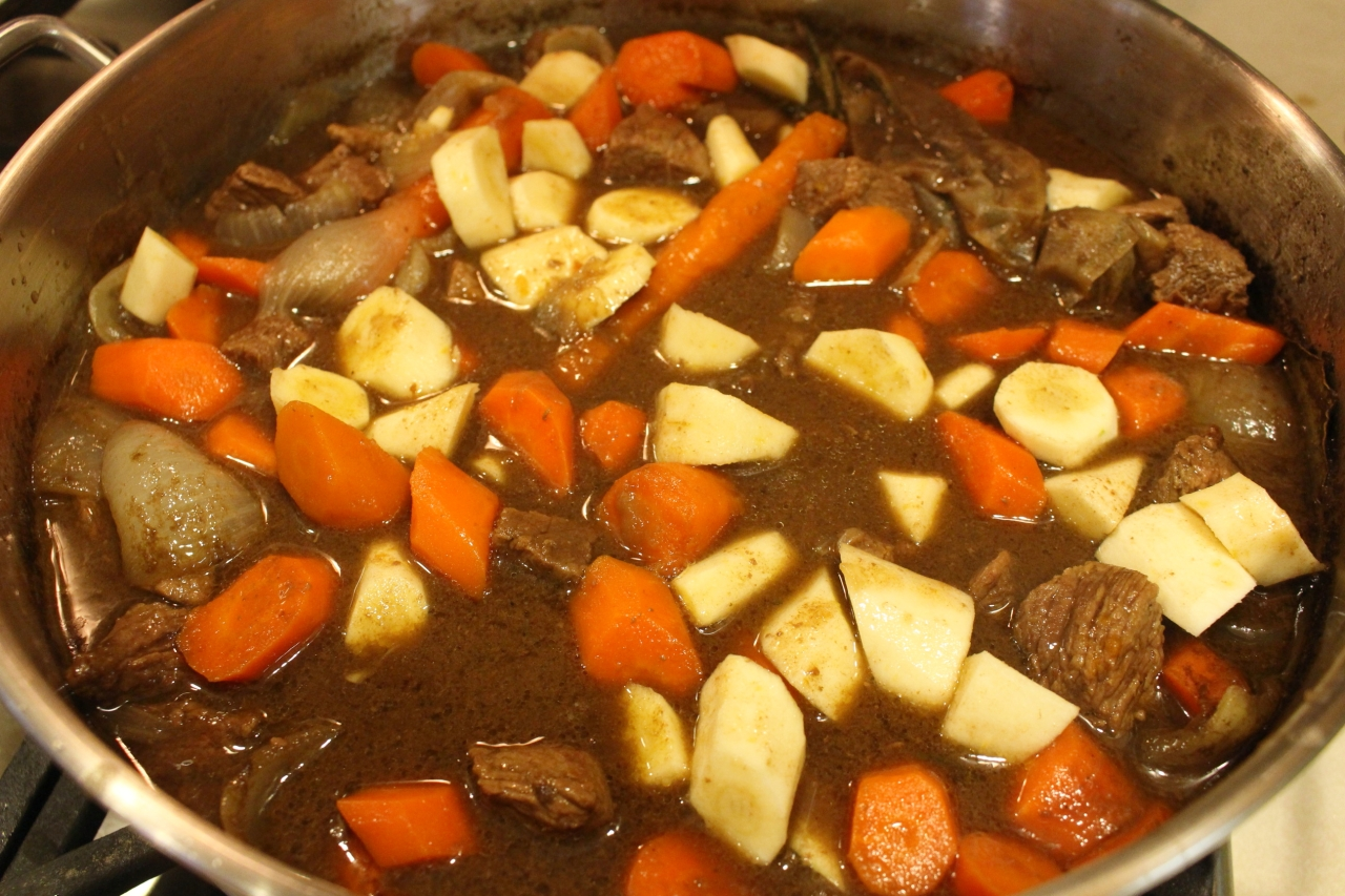 Guinness Irish Beef Stew on stovetop with veggies added